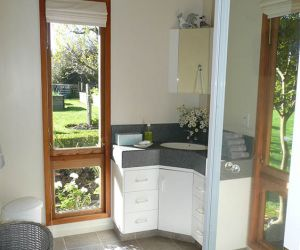 Attractive bathroom - shower, vanity unit, hair drier and heated towel rail